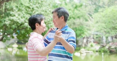 old couple dance in park